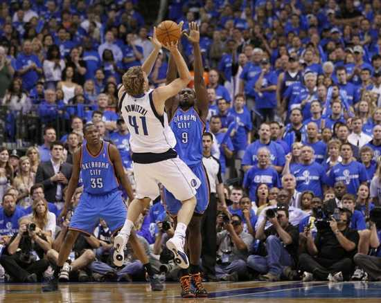 Dallas-Mavericks-Forward-Dirk-Nowitzki-41-Shoots-A-Fade-Away-Jump-Shot-In-The-Second-Half-Against-Oklahoma-City-Thunder-Power-Forward-Serge-Ibaka-9-During-Game-1-Of-The-Nba-Western
