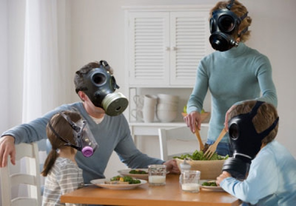 Family indoors wearing gasmasks to survive the poor-quality air