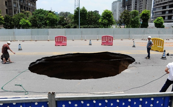 This-Huge-Sinkhole-Suddenly-Appeared-On-A-Main-Road-In-Changsha-Capital-Of-Southern-Chinas-Hunan-Province.-The-Enormous-Hole-Opened-Up-At-Around-1Am-And-Swallowed-Up-A-Car-Killing-One-And-Injuring-A-Further-Three-People.