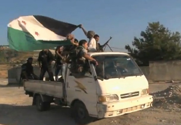 FSA_soldiers_in_truck_moving