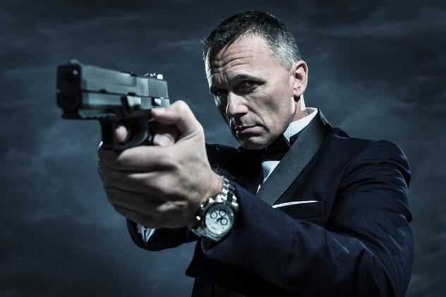 Spy in Tuxedo Aiming Gun