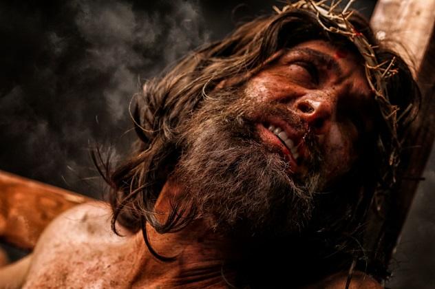 Jesus Christ on cross in pain