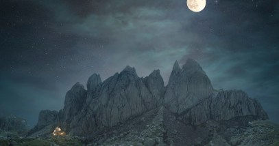Mountain landscape with rocky peaks at night