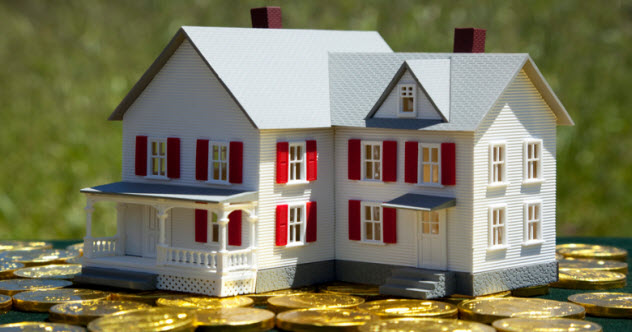 feature-2-dollhouse-on-money_13318489_SMALL
