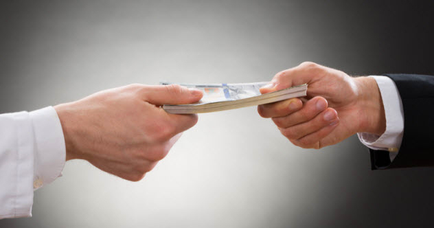 feature-e-money-changing-hands_90063695_SMALL
