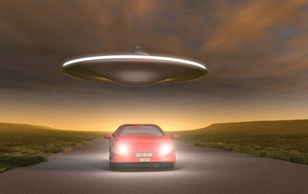 7a-flying-saucer-chasing-car-178090909