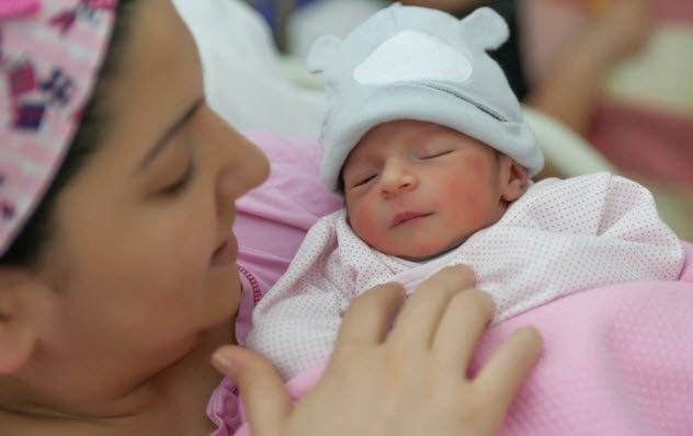 1a-woman-with-newborn-522778346