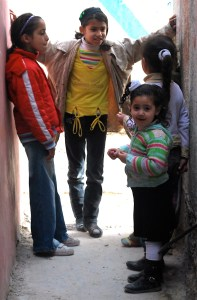 A group of girls talk together in an alleyway in the Dheisheh Refugee Camp. Bethlehem, 2011. credit: Mateo Hoke/Cate Malek