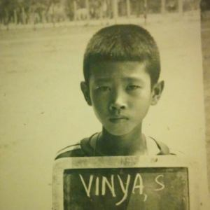 """""""This picture was taken at a refugee camp in Thailand in 1982. I was 9 years old then. As a child in the camps I had many responsibilities, such as babysitting my baby sister, getting in line to fetch water, and going to school, where we not only learned Lao, but Thai and English. We were poor, but optimistic about the future would hold in amaylika (America). A year later, our family was sponsored by a Lutheran Church in Wisconsin. We arrive in Milwaukee on September 27, 1983."""" -Dr. Vinya Sysamouth, Center for Lao Studies, San Francisco, CA"""