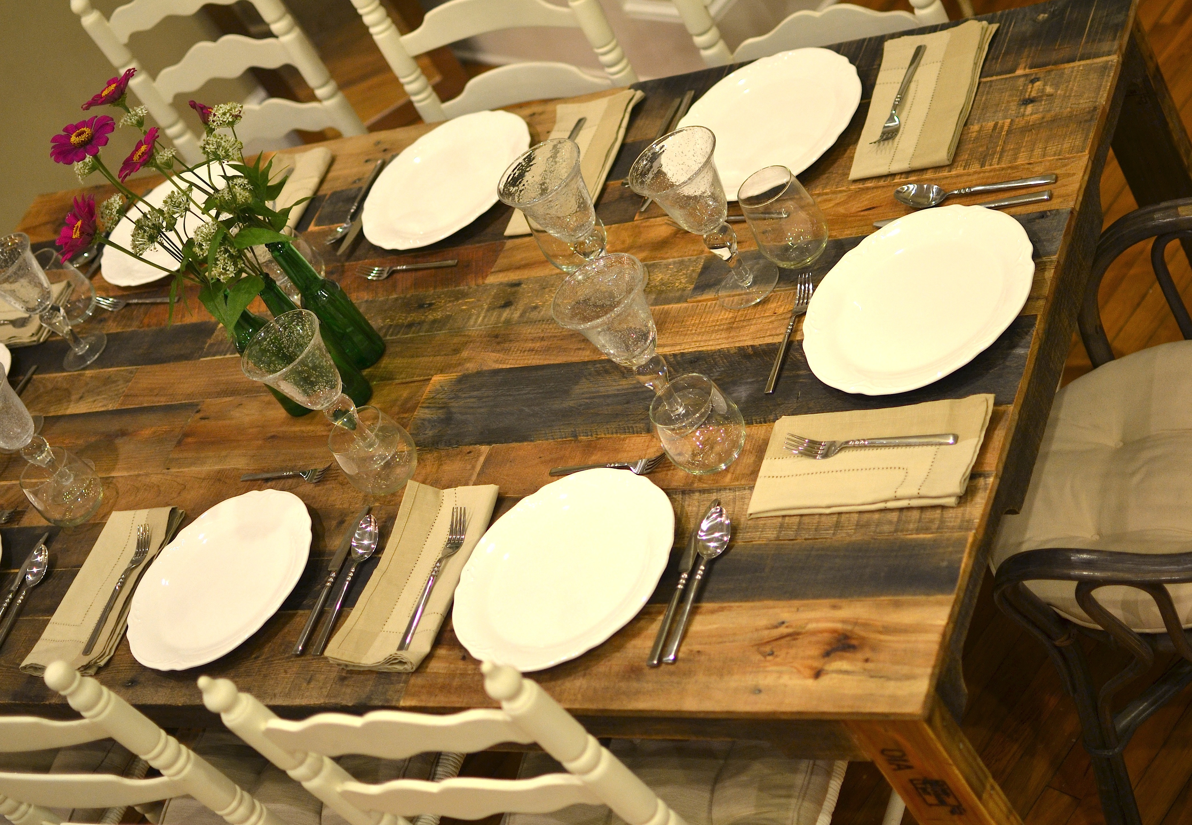 the shipping pallet dining table diy kitchen table plans The shipping pallet table seats eight comfortably ten if we re squeezing