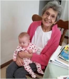 Kathryn Kramer holding her great-granddaughter