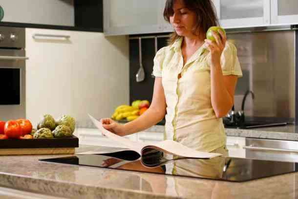 standing-in-kitchen-with-cookbook-2-mcrsft-img
