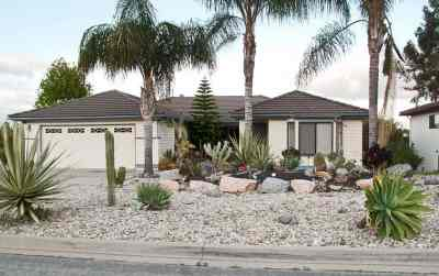 House with xeriscape instead of a front lawn in Hidden Meadows, CA photo by Downtowngal licensed under CC