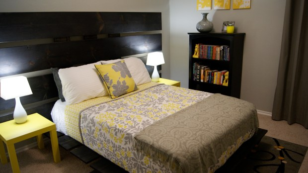 moved permanently gray and yellow bedroom
