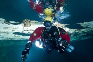 Reflections of Underwater Photographers in Tank Cave