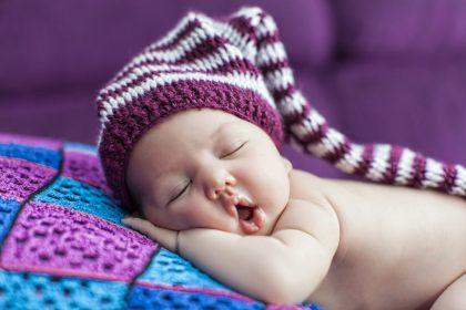 Dreams Baby sleeping purple background