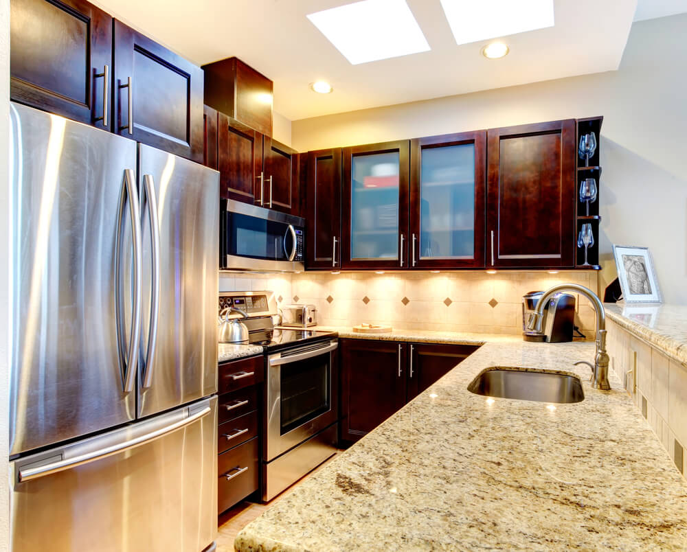 46 gorgeous kitchens with dark cabinets pictures cabinets kitchen Under cabinet lighting and a very reflective and large refrigerator is a very clever design trick