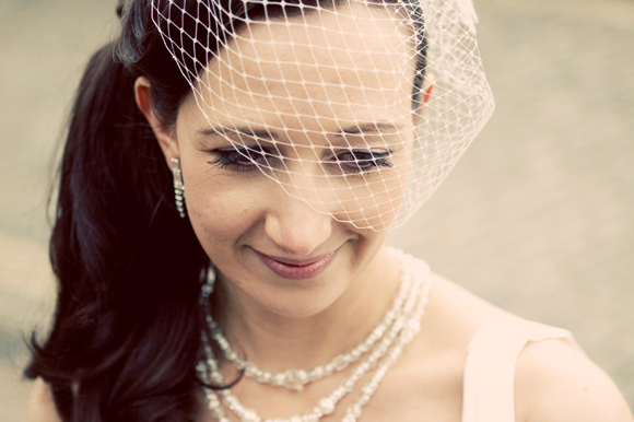 A Backless Wedding Dress A Birdcage Veil And A Touch Of