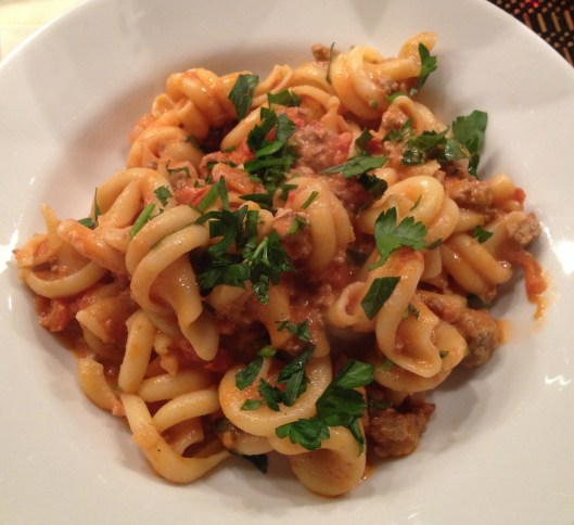 Lamb ragu with Girelle pasta from Fairway Market in a white bowl.