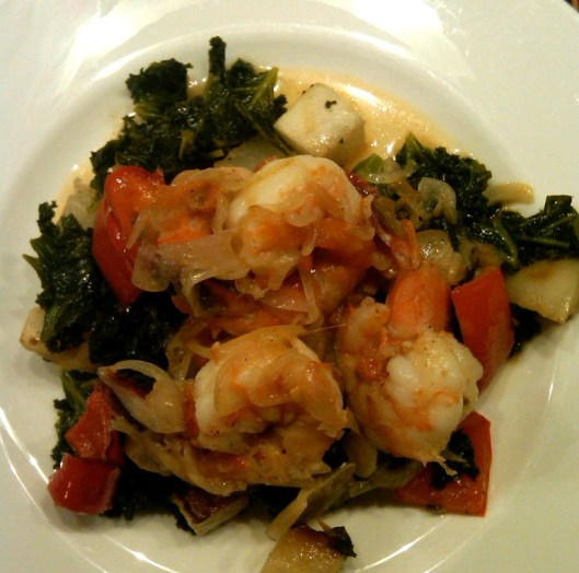 Sauteed shrimp on a white plate.