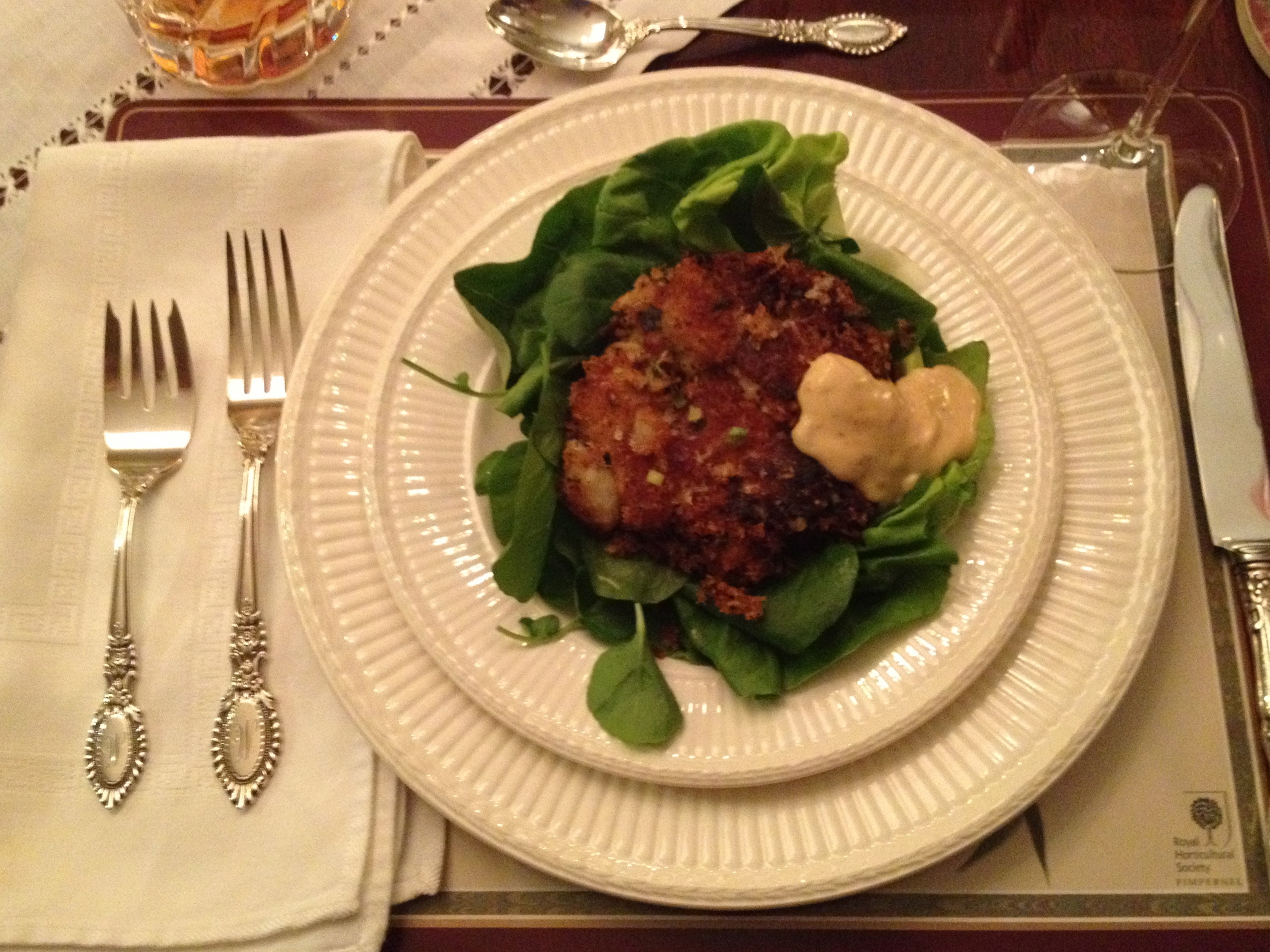 Crab cake on a Boston lettuce leaf with organic watercress and chipotle mayo