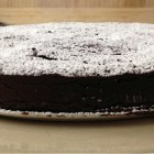 Silky chocolate cake, side view on a plate.