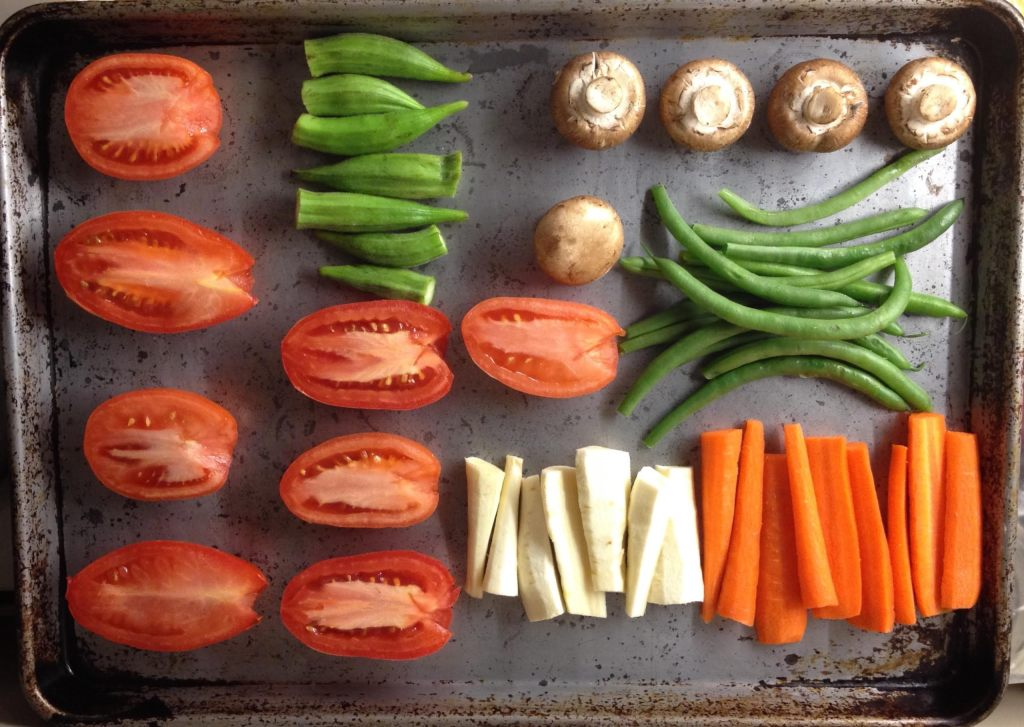Vegetables lined up to roast in the oven.