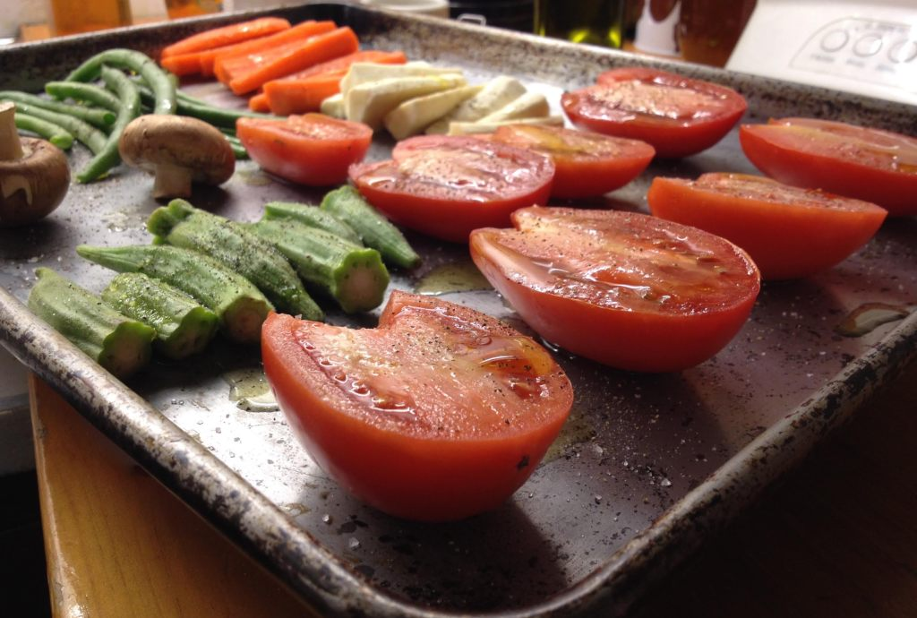 Cut vegetables with olive oil and salt ready to roast.