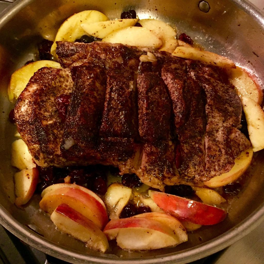 ust Cook Herbed Coffee Rub on pork cooking in skillet.