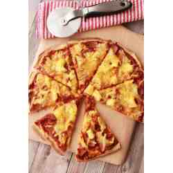 Small Crop Of Pizza On Pineapple