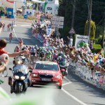 After a late crash, the splintered leading group charge up the hill