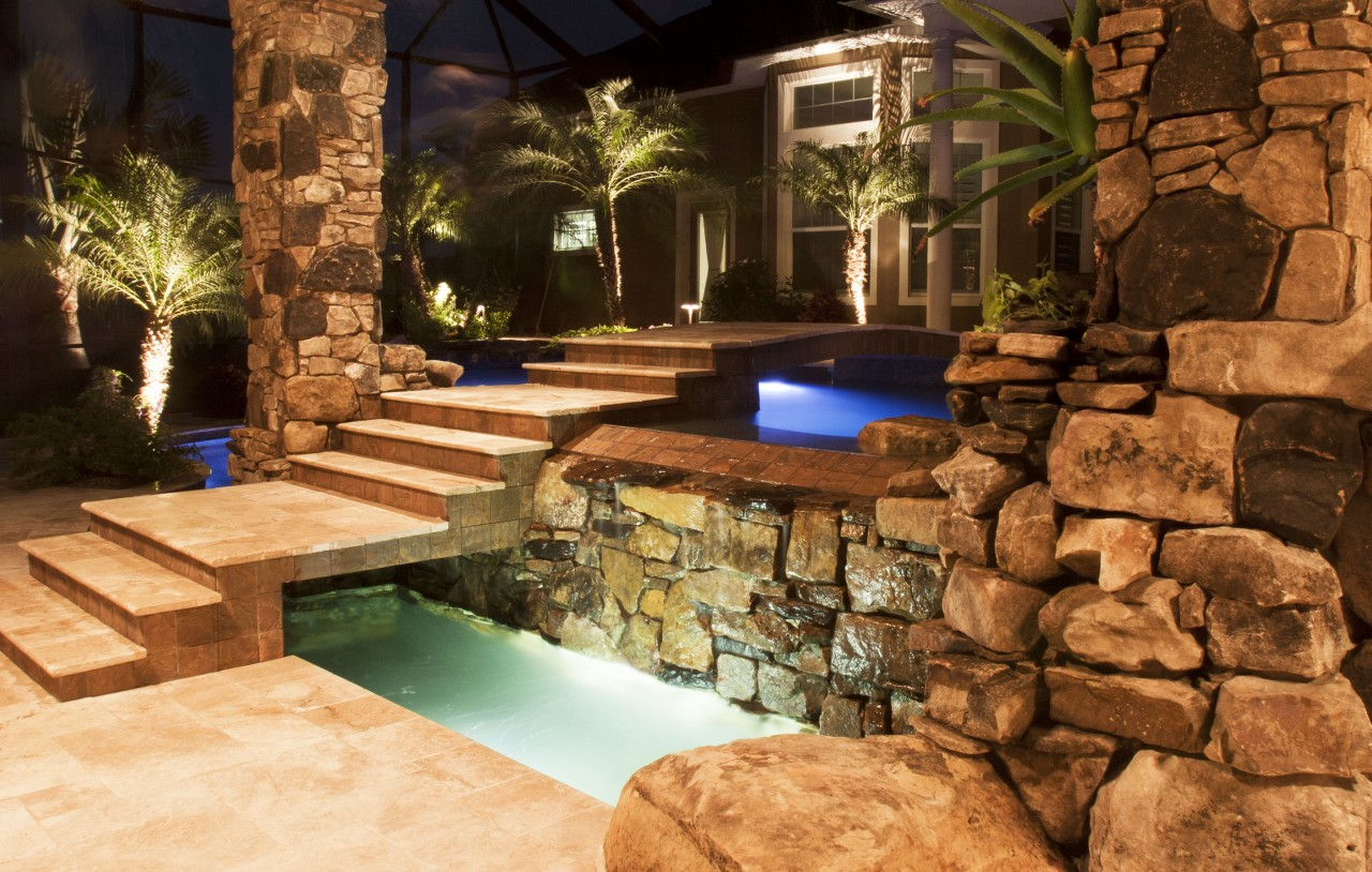 Swimming Pool And Spa With Outdoor Kitchen Bar And