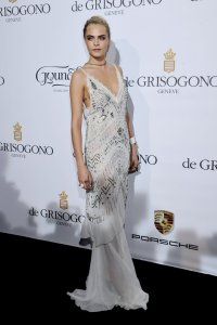 Cara Delevingne, a guest of de Grisogono's Fawaz Gruosi at the Fatale dinner at Hôtel du Cap-Eden-Roc, Antibes, May 20, 2014.