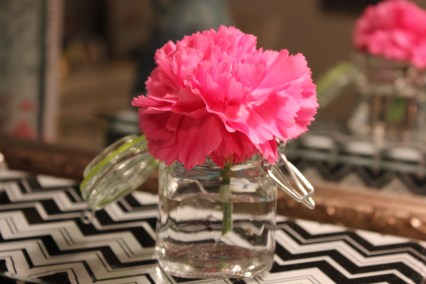{and itty bitty vase with a bright bloom}