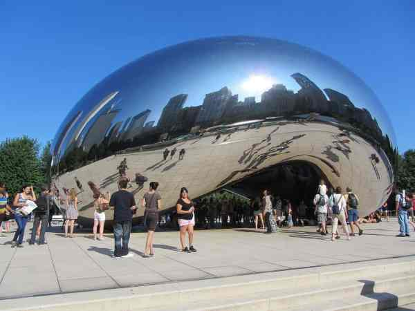 Cloud Gate reflecting the Chicago skyline