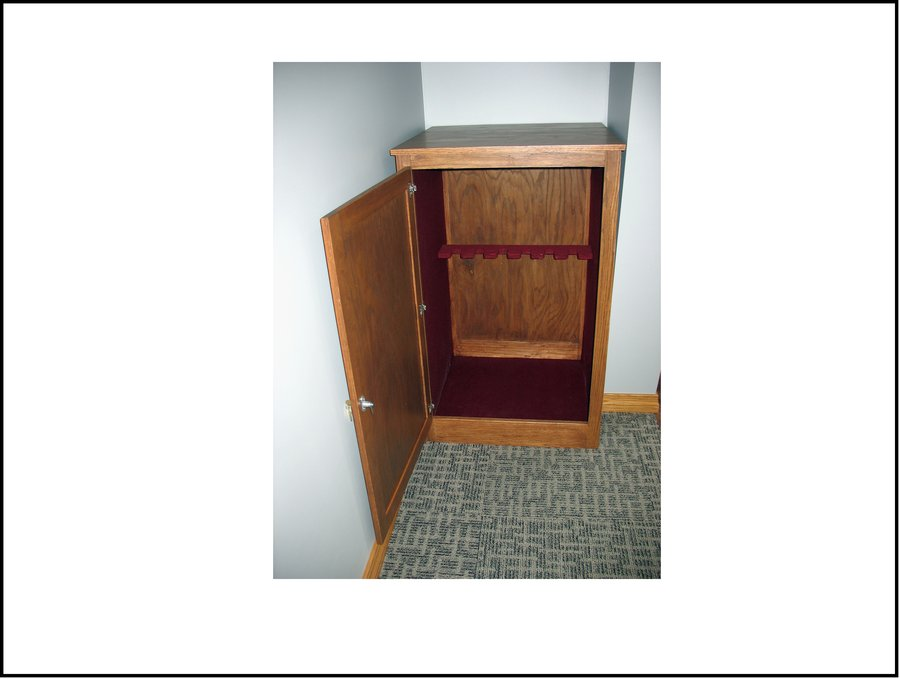 Lockable red oak electric guitar storage cabinet for
