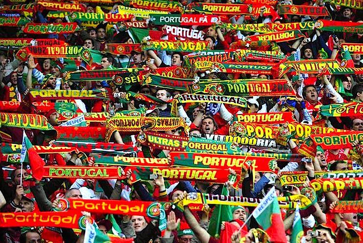 Portugal fans hold scarves aloft before their Group A Euro 2008 soccer match against Turkey at the Stade de Geneve in Geneva