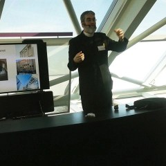 "Brother Guy Consolmagno giving a presentation in the ""Clergy Contribution to Science"" series at Chicago's Adler Planetarium (Credit: Susan Barreto)"