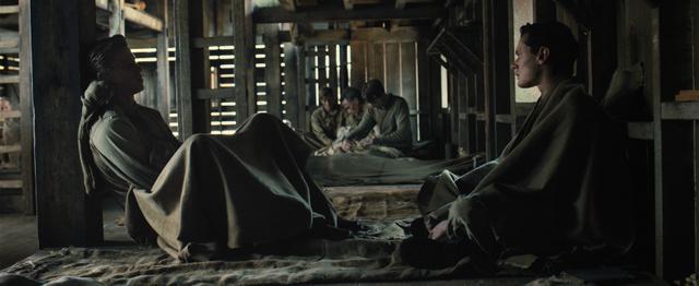 "Universal Pictures Commander John Fitzgerald (Garrett Hedlund) speaks with Louis ""Louie"" Zamperini (Jack O'Connell) in the barracks"