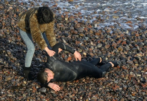 Under the Skin movie - Scarlett Johansson pulling diver