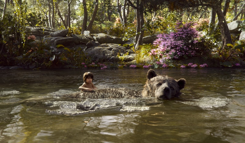 the jungle book review - Baloo and Mowgli-min