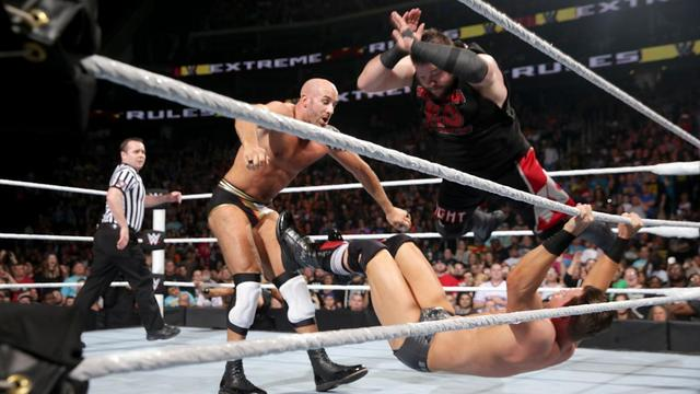 WWE Extreme Rules 2016 - Kevin Owens splashes The Miz while Cesaro watches