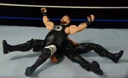 WWE Elite 43 Kevin Owens figure review - senton on Roman Reigns