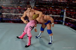 wwe-elite-40-rick-rude-figure-review-headlock-punch-to-paul-orndorff