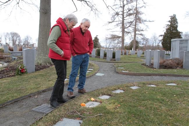 Susan Terhune and John Cabral visit the grave of their son, Eric Cabral, on the one-year anniversary of his death. Eric died 12 days after his mandated return to Rhode Island from a Florida drug-treatment program; he had violated his probation by leaving the state without permission. The Providence Journal/Sandor Bodo
