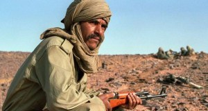A Polisario fighter on guard near the front line with Morocco, 15 June 1988, in Polisario-controlled Western Sahara. The Polisario front, an armed movement backed by Algeria, is fighting for the independence of Western Sahara, a former colony of Spain that was invaded and annexed by Morocco in 1975. The provisional government of the Polisario, the Sahrawi Arab Democratic Republic, is recognised by 71 countries as the legitimate government of the Western Sahara.         (Photo credit should read MIKE NELSON/AFP/Getty Images)