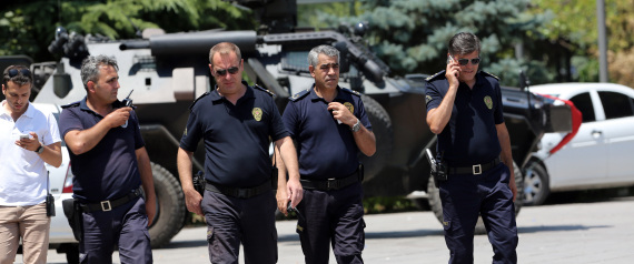 Turkish security officers walk outside a courthouse where prosecutors are questioning 27 generals, including an ex-Air Force commander suspected of being coup ringleader according to the state-run Anadolu Agency, in Ankara, Turkey, Monday, July 18, 2016. Warplanes patrolled Turkey's skies overnight in a sign that authorities feared that the threat against President Recep Tayyip Erdogan's government was not yet over, despite official assurances that life has returned to normal after a failed coup. (AP Photo/Burhan Ozbilici)
