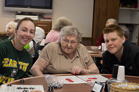 HCA senior Gabby Nowakowski, ECF resident Gertrude Dixon and HCA senior Greg van Lieshout enjoy a game of bingo.