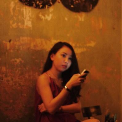 A girl waits for her boyfriend.
