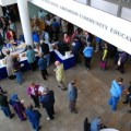 Maine beekeepers enjoy socializing, snacking, perusing raffle items and sampling honey contest entries in USM's Abromson Center lobby.